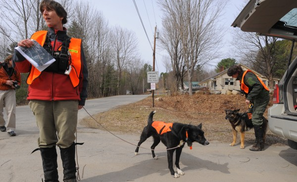 Kelly Pontbrian (left) and Leslie Howe get ready to search an area off Heath Street in Oakland as teams search for Ayla Reynolds in the greater Waterville area Saturday.