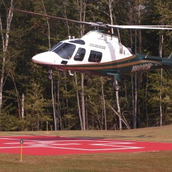 A LifeFlight helicopter lands at Millinocket Regional Hospital.