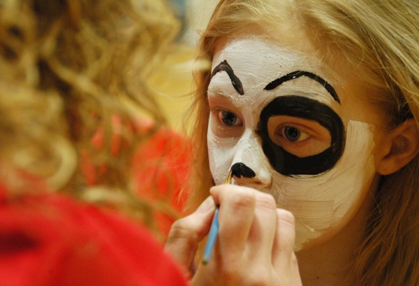 Kortnie Trott of Lincoln has her face painted like a puppy's by Michelle Russell, director of the Lincoln KidCare America After-School Mentoring Program, at the annual Lincoln Lakes Region Chamber of Commerce Expo at Mattanawcook Academy on April 10, 2010.