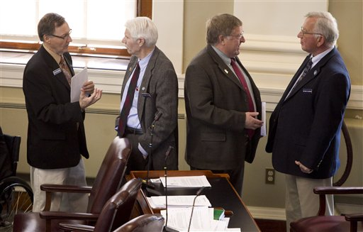In this April 13, 2012 photo, State Reps., from left: Peter Edgecomb, R-Caribou, Bernard Ayotte, R-Caswell, James Parker, R-Veazie, and Wesley Richardson, R-Warren, confer before the start of a House session, at the State House in Augusta, Maine.