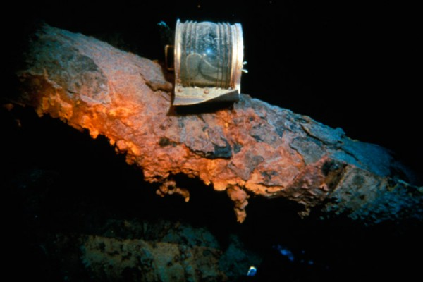 This well-preserved brass running light on the fallen foremast is approximately 8 inches wide.