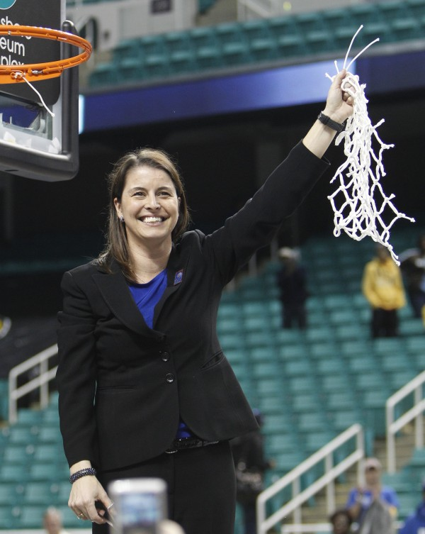 "Duke head coach Joanne P. McCallie waves the net after her team beat North Carolina to win the Atlantic Coast Conference title in 2011. The former University of Maine coach will be in Portland on Friday, April 27, 2012 and Bangor on Saturday, April 28, 2012 to promote her just-published book, ""Choice not Chance. Rules for Building a Fierce Competitor."""