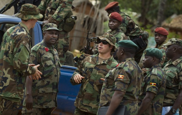U.S. Army special forces Master Sergeant Eric, center, who would only give his first name in accordance with special forces security guidelines, speaks with troops from the Central African Republic and Uganda, in Obo, Central African Republic, Sunday, April 29, 2012.
