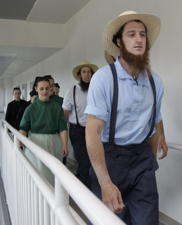 Members of the Amish community leave the U.S. Federal Courthouse Thursday, April 19, 2012, in Cleveland.