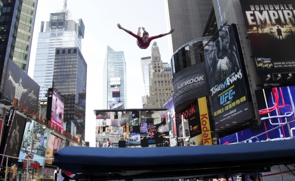 Gymnast Alaina Williams performs on a trampoline in New York's Times Square during U.S. Olympic Team festivities on Wednesday, April 18, 2012. The event marks 100 days until the London Olympics.