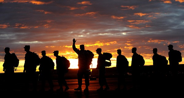 A soldier waves to his family as the Montana Army National Guard 484th MP Company departs from Edwards Jet Center in Billings, Mont., on Tuesday, April 17, 2012. The unit is headed to Afghanistan.
