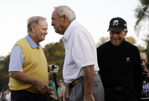Honorary starters (from left) Jack Nicklaus, Arnold Palmer and Gary Player prepare to tee off on the first hole before the first round of the Masters golf tournament Thursday, April 5, 2012, in Augusta, Ga.