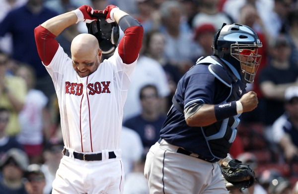Tampa Bay Rays catcher Jose Molina pumps his fist after Boston Red Sox's Cody Ross (left) struck out to end the game in Tampa Bay's 1-0 win in a baseball game at Fenway Park in Boston Monday, April 16, 2012.