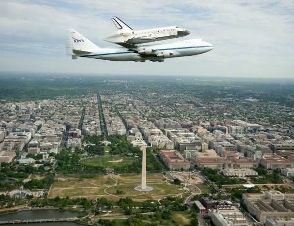 This handout photo provided by NASA shows the Space shuttle Discovery, mounted atop a NASA 747 Shuttle Carrier Aircraft, flying over Washington skyline, including the Washington Monument, as seen from a NASA T-38 aircraft on Tuesday, April 17, 2012. Discovery, the longest-serving orbiter will be placed to its new home, the Smithsonian's National Air and Space Museum's Steven F. Udvar-Hazy Center in Chantilly, Va.