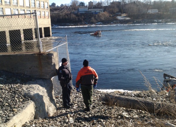 Divers with the Maine Warden Service and Maine State Police join other Waterville area operations Wednesday, Jan. 11, 2012, as the search for Ayla Reynolds continues. Divers in the photo are searching between a dam near the Hathaway Creative Center and the Carter Memorial Bridge in Waterville.
