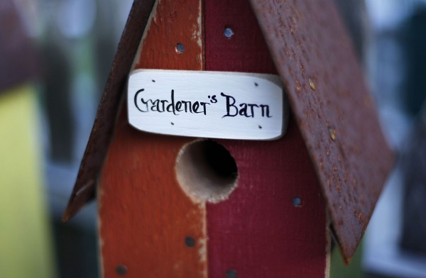A sign handpainted by Lynnette DiPietro decorates her husband's birdhouse.