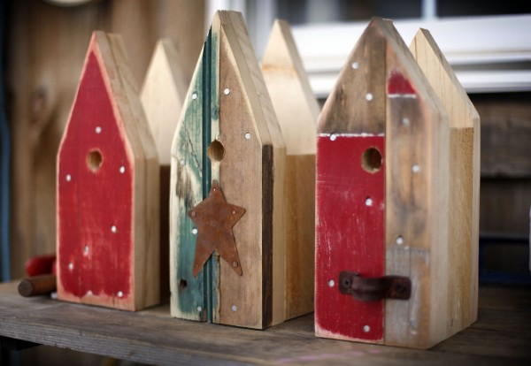Wood salvaged from old doors give a well-worn look to birdhouses under construction in Tony DiPietro's workshop.