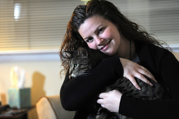 Janet Cress, with cat Fred, is hoping to land a job as a teacher. She is close to $60,000 in college debt. (Sharon Gekoski-Kimmel/Philadelphia Inquirer/MCT)