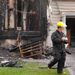 Rescue crews save woman from burning home