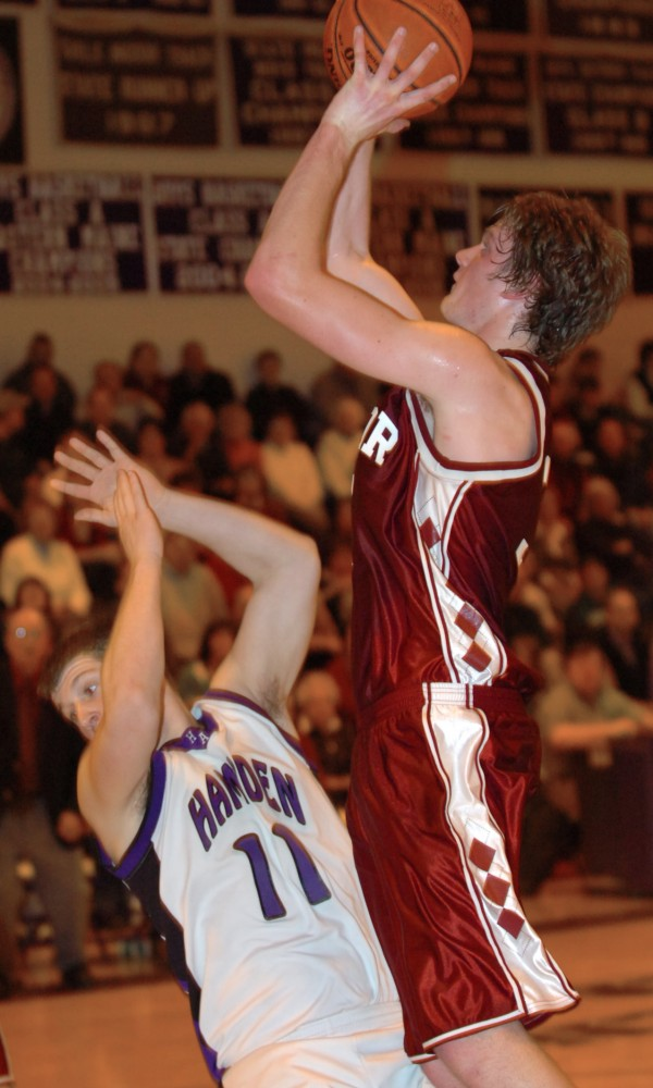 Bangor's Clark Noonan (right) runs into Hampden's Cody Miller (left) on his way to the basket in the second half of a game Jan. 7, 2010 in Hampden.