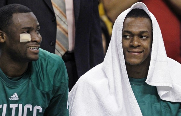 Boston Celtics point guard Rajon Rondo (right) smiles as he sits on the bench with guard Keyon Dooling during the second half against the Milwaukee Bucks in Boston, Thursday night. The Celtics won 87-74 and open their first-round playoff series against the Atlanta Hawks Sunday night.