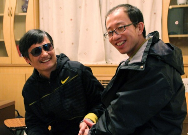 Blind Chinese legal activist Chen Guangcheng, left, meets with Hu Jia at an undisclosed location. Chen, an inspirational figure in China's rights movement, slipped away from his well-guarded rural village on Sunday night, April 22, 2012.
