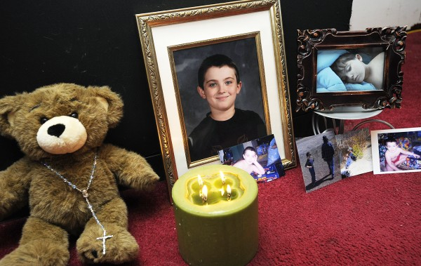 A memorial is placed at the home of 10-year-old Jesse Ryan of Lewiston last year. Ryan was stabbed to death in June 2010 in Amity.