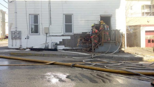 Firefighters enter a building at 158 Pierce St. in Lewiston after a fire broke out in the building Saturday, March 31, 2012.