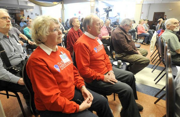 Judy Hurst (left) of Old Orchard with her husband, Wesley Hurst, listens to speakers at the Tax Day Rally held at the Franco-American Heritage Center in Lewiston on Sunday. The featured speaker for the event was Gov. Paul LePage.