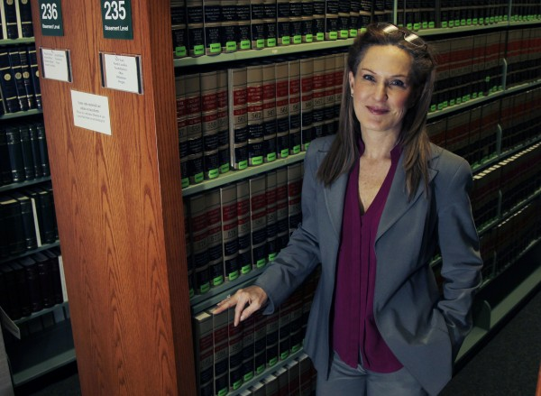 Attorney Wendy Murphy, at the law library at the New England School of Law in Boston, says colleges cave too easily in the face of threatened lawsuits from students accused of sexual violence.