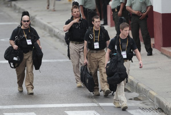 U.S. secret service agents walk around the Convention Center in Cartagena, Colombia, prior to the opening ceremony of the 6th Summit of the Americas at the Convention Center in Cartagena, Colombia, Saturday, April 14, 2012.