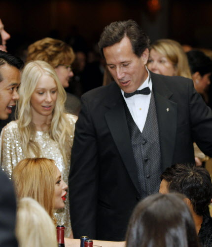 Former Sen. Rick Santorum, R-Pa.,  talks with Lindsay Lohan at the the White House Correspondents' Association Dinner, Saturday, April 28, 2012 in Washington.