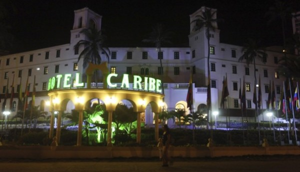 People walk past Hotel El Caribe in Cartagena, Colombia, late Thursday April 19, 2012. Eleven Secret Service employees are accused of misconduct in connection with a prostitution scandal at the hotel last week before President Barack Obama's arrival for the Summit of the Americas.