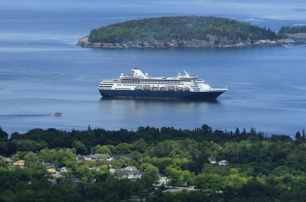 The  Maasdam, a 1,258-passenger cruise ship, sits at anchor in Frenchman Bay off Bar Harbor in June, 2010. On Thursday, May 3, the ship is scheduled to make the first of 120 cruise ship visits scheduled for Bar Harbor this year. The Maasdam is expected to drop anchor nearby in Frenchman Bay 17 times between early May and mid-October.