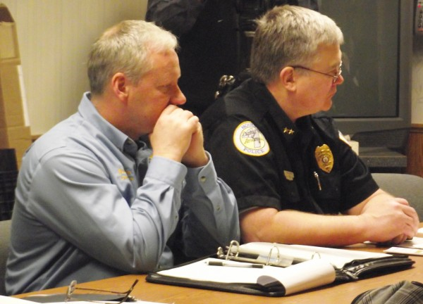 Presque Isle Police Chief Matt Irwin (left) and Houlton Police Chief Butch Asselin listen during a press conference in Caribou on Thursday, April 12, 2012. Aroostook County law enforcement officers will be out in full force starting Friday, April 13, thanks to a federal grant that will help them crackdown on underage drinking, driving under the influence, and charging those who provide alcohol.