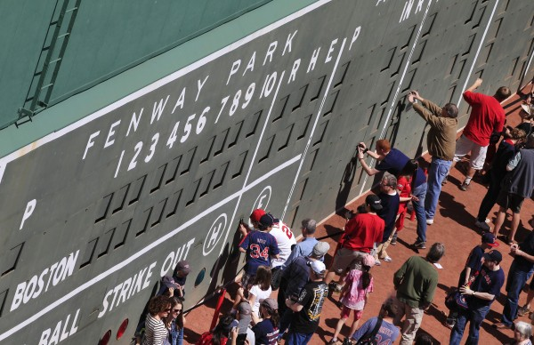 People view the scoreboard section of the Green Monster left field wall during &quotopen house&quot at Fenway Park in Boston, Thursday, April 19, 2012, part of the Boston Red Sox's celebration of the 100th anniversary of the first regular-season baseball game at the park.