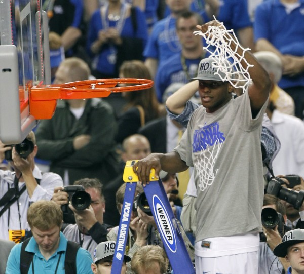 Kentucky's Darius Miller cuts down the net after the NCAA championship game against Kansas Monday night, April 2, 2012, in New Orleans.  Kentucky won 67-59.