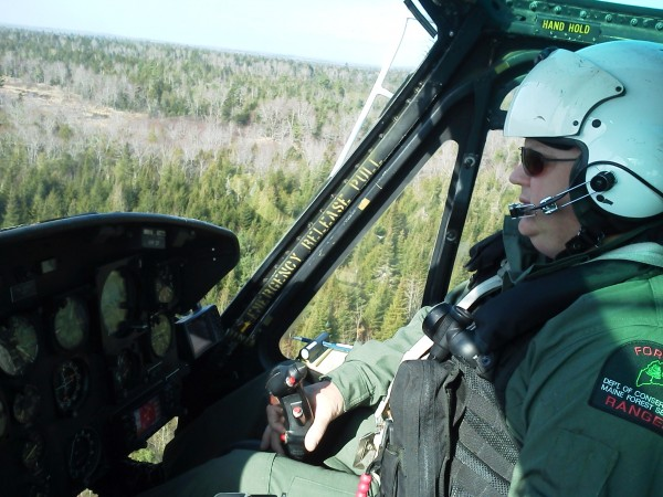 Maine Forest Service Ranger Pilot Chris Blackie pilots a helicopter while searching for 24-year-old Freeport man, Dean Levasseur, on Wednesday, April 25, 2012 in Howland.