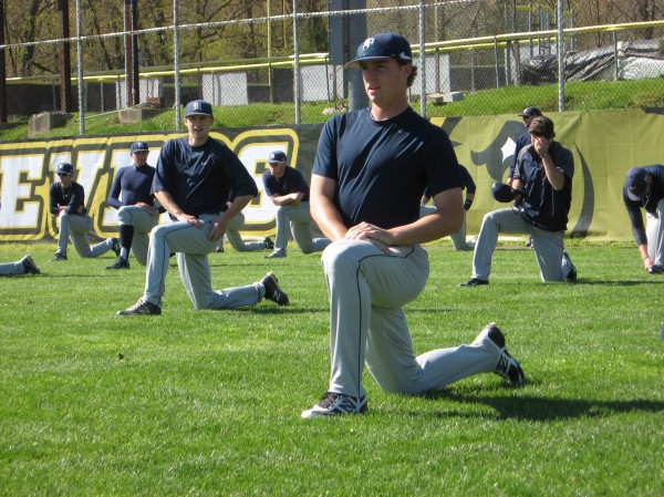 University of Maine baseball players warm up before their doubleheader with UMBC on Saturday in Baltimore, Md.