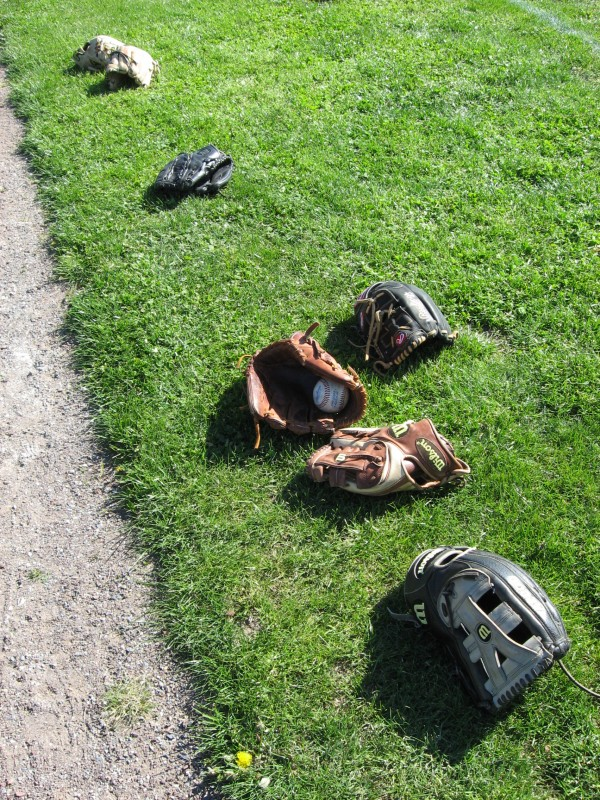 Baseball gloves await their owners before the University of Maine begins its doubleheader against UMBC on Saturday in Baltimore, Md.