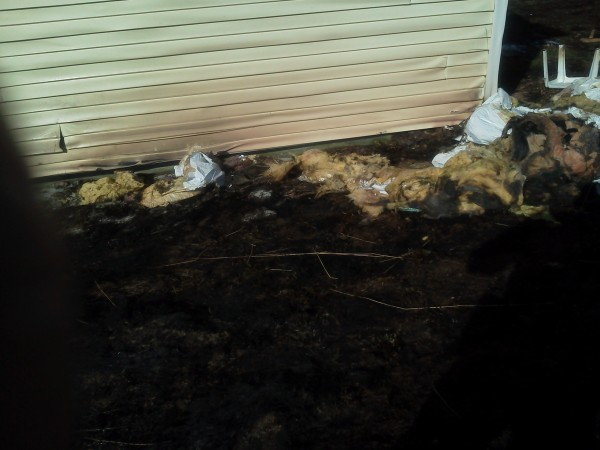 A campfire that got out of control on outer Broadway in Lincoln on Wednesday, April 18, 2012, singed siding on a home.
