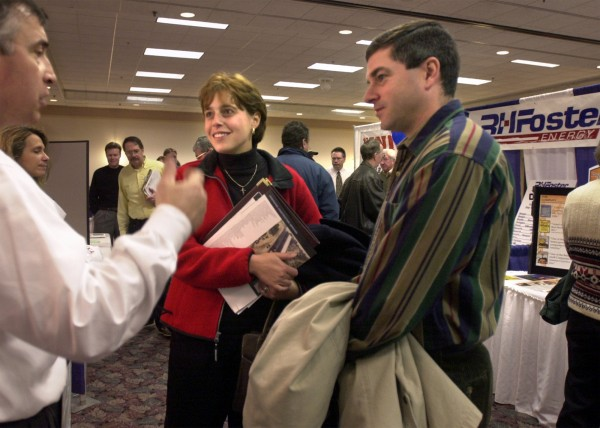 Michelle and Mike Atherton of Bucksport speak with Daniel A. Leone III, director of business development for Lane Construction Corp., at a Bangor Region Chamber of Commerce job fair in March 2002 at the Bangor Civic Center.