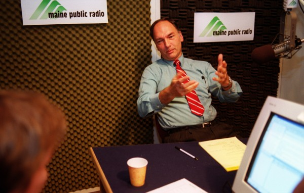 John Michael talks with Fred Bever of Maine Public Radio after finishing a live call-in show in October 2002.