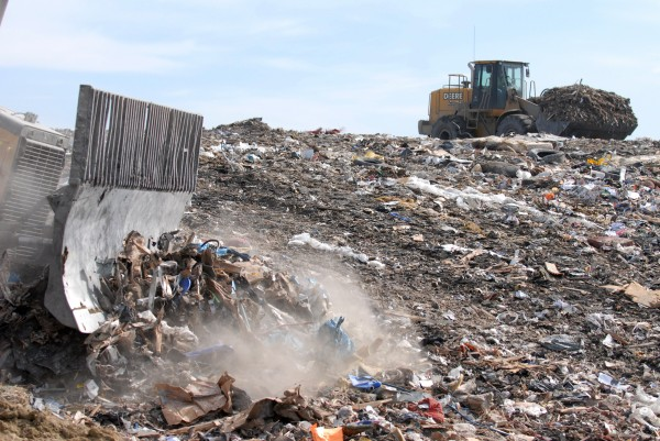 Heavy machinery moves trash atop Juniper Ridge Landfill in Old Town on March 11, 2010.