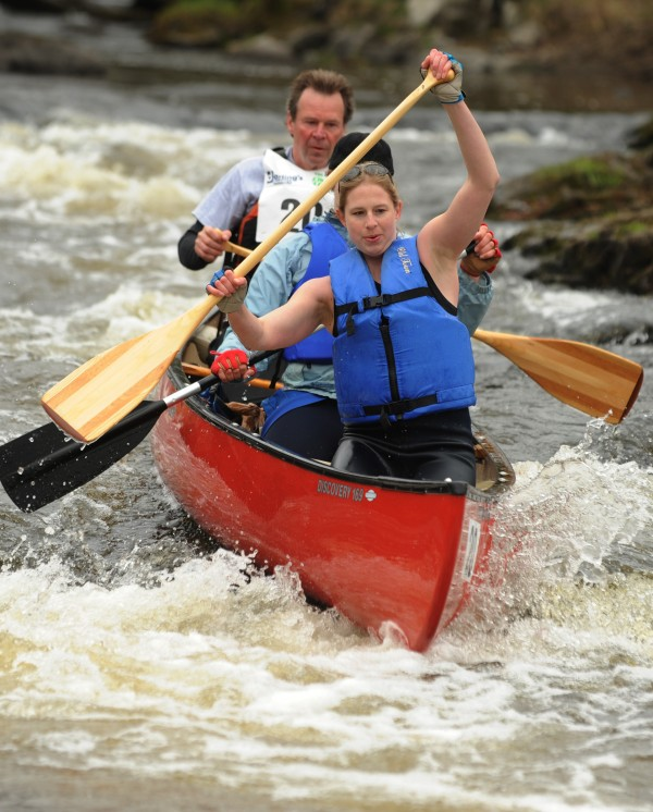 The team of Devan Oleksyk (front), Cara Oleksyk (center) and Steve Oleksyk of Frankfort is one of the first canoes to attempt the low water running off Six Mile Falls during the 46th annual Kenduskeag Stream Canoe race on Saturday, April 21, 2012.