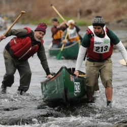 The team of Adam Vedoni and Dan Cassaday runs through low water near the start of the 46th annual Kenduskeag Stream Canoe race on Saturday, April 21, 2012.