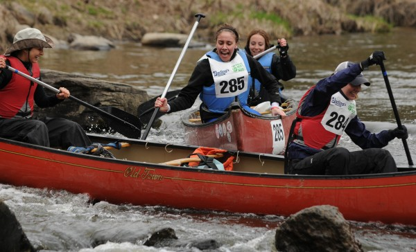 The team of Julia Brown and Erin Thomas (top) collides with a canoe paddled by Alexandra Pastore and Jena Jones near the start of the 46th annual Kenduskeag Stream Canoe race on Saturday, April 21, 2012.