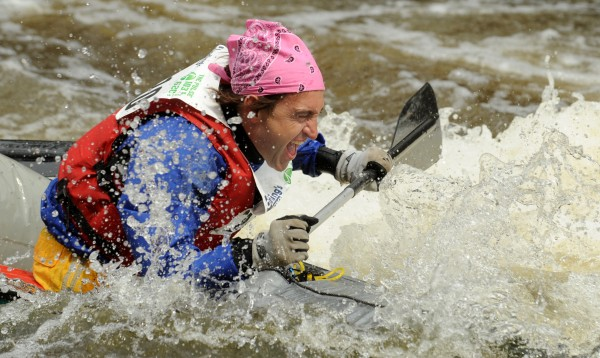 A competitor reacts as his canoe gets swamped with cold water at the &quotShopping Cart&quot during the 45th annual Kenduskeag Stream Race in April 2011.