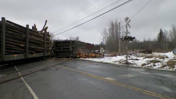 Travis Carll, 32, of Linneus suffered only a minor hand injury when his loaded log truck collided with a moving train also loaded with logs at about noon on Monday at a railroad crossing on Route 11 in Masardis, according to Maine State Police. Route 11 was closed for several hours as heavy equipment was brought in to clear the roadway.