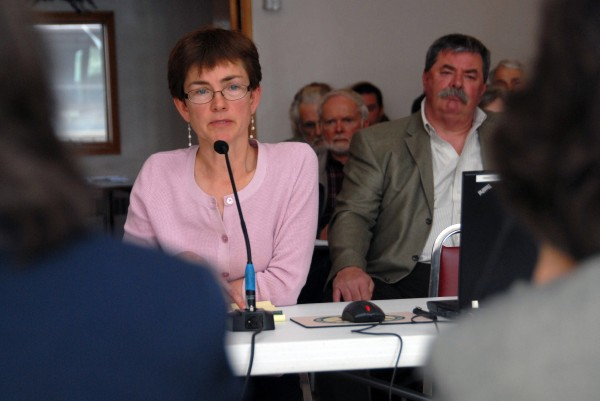 Attorney Juliet T. Browne speaks in favor of a proposed industrial wind site on Bowers Mountain while a project opponent, Partnership for the Preservation of the Downeast Lakes Watershed group President Kevin Gurall (right), listens during a LURC hearing in Lincoln on Friday, April 6, 2012.