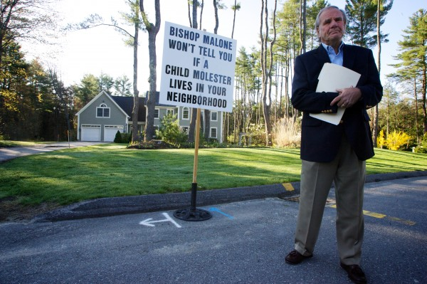 Paul Kendrick of the Ignatius Group protests outside Bishop Richard Malone's house in Falmouth Thursday April 26, 2012.