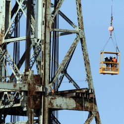 NH-Maine bridge's center span floats out to sea toward recycling center