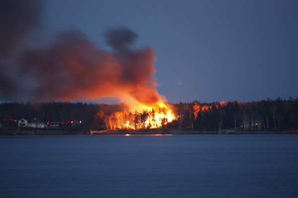 A fire on Mere Point in Brunswick as seen across Maquoit Bay from Freeport.