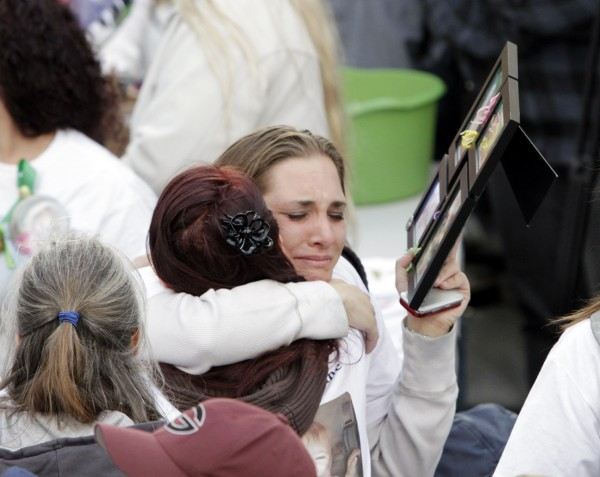 Trista Reynolds, mother of missing toddler Ayla Reynolds, is overcome by grief as she hugs a well wisher who presented her with photos of her missing daughter, at a gathering in Portland, Maine, on Wednesday, April 4, 2012.  About 100 people held a vigil to mark the second birthday of the girl who disappeared from her father's home days before Christmas.