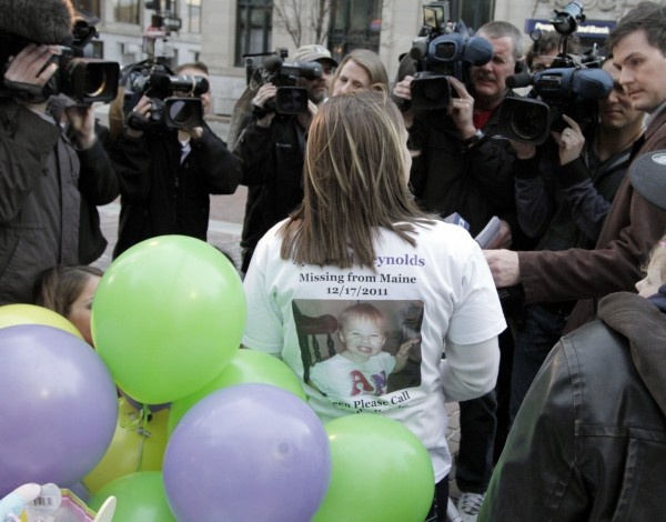 Trista Reynolds, back to camera, mother of missing toddler Ayla Reynolds, talks to the media during  a gathering in Portland, Maine, on Wednesday, April 4, 2012. About 100 people held a vigil to mark the second birthday of the girl who disappeared from her father's home days before Christmas.